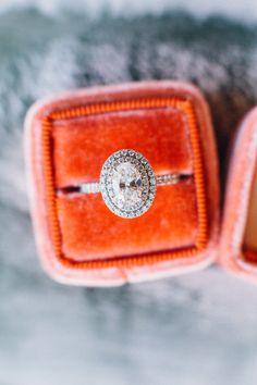 Double halo oval cut engagement ring: http://www.stylemepretty.com/california-weddings/los-gatos/2015/12/23/rustic-elegant-santa-cruz-wedding/   Photography: Melissa Fuller - http://www.melissafullerphotography.com/