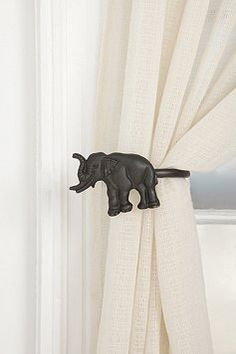 Curtain Tie-Back Let the sun shine through those windows as these Elephant Tie-Backs hold your Thinking Bright Star Curtains.Let the sun shine through those windows as these Elephant Tie-Backs hold your Thinking Bright Star Curtains. Elephant Curtains, Elephant Room, Elephant Stuff, Elephant Lamp, Elephant Home Decor, Elephant Facts, Elephant Tapestry, Grey Elephant, African Elephant