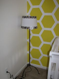 Bumble Bee Nursery - re-purposed lamp shade. It had ugly Christmas trim that I picked up for 80% off. Took that off and then added my own ribbon. The light fixture was on clearance at ikea. Total investment $15.