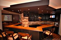 Here's a sports bar in the basement.  A pro bartender could run this place.  There's a large viewing room adjacent to the bar.  This is a true man cave design.