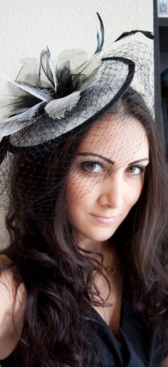 Delilah White and Black Couture English Hat Sinamay Birdcage Fascinator Headband for Bridal, weddings, parties, derby, special occasion. $55.00, via Etsy.