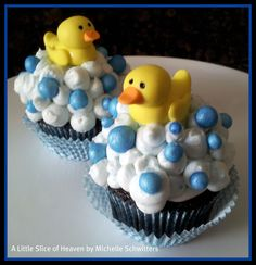 Milk chocolate cake with chocolate cookie dough filling. Topped with vanilla buttercream. Fondant ducks and shimmer soap bubbles.
