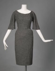 """Day Dress, Charles James (1906-1978), Samuel Winston Inc. (manufacturer), New York: 1951, wool crepe. """"James created the wide curve of this collar using a bat-making techniques: numerous small stitches force the material in the desired direction, similar to the way the curve of a hat's brim is held in place. To make the slim pencil skirt wearable, he added a controlled flare of fabric to the back. The flare both allowed the wearer to walk naturally and pulled the skirt back into shape..."""""""