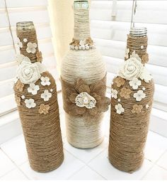 Twine Wrapped Wine Bottles with Burlap and flower accents Twine Wrapped Wine Bottles with Burlap and flower accents Twine Wine Bottles, Wrapped Wine Bottles, Painted Wine Bottles, Decorated Wine Bottles, Glass Bottle Crafts, Wine Bottle Art, Diy Bottle, Twine Crafts, Decor Crafts