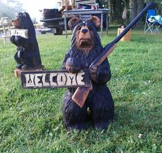 Chainsaw Carved Welcome Bear holding a Gun by carvnstitch on Etsy, $200.00