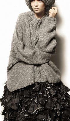 grey oversize knit with black shiny ruffles skirt
