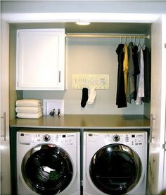 Love the spot for hanging clothes above the dryer! Although, I would definitely need a step stool to be able to reach it.