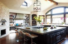 Omg! This island is amazing! Cute counter stools too! Is that a pizza oven?!