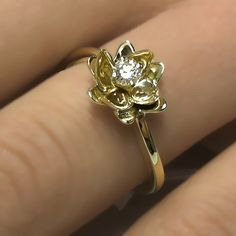 Unique Flower Design 0.40 carats Round Cut Natural Diamond Engagement Ring 14k White or Yellow Gold. $760.00, via Etsy.