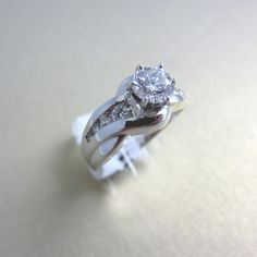 Diamond complete engagement ring in white gold under $2,999!