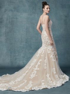 Romantic lace motifs drift over tulle in this fit-and-flare wedding dress, accenting the illusion plunging sweetheart neckline. Featuring delicate spaghetti straps, and lined with shapewear for a figure-flattering fit. Wedding Dress Pictures, Best Wedding Dresses, Perfect Wedding Dress, Bridal Dresses, Wedding Attire, Bridal Gown, Provonias Wedding Dress, Maggie Sottero Wedding Dresses, Vestidos Boutique