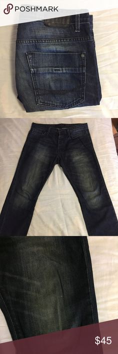 Dark Wash Calvin Klein Jeans Button Fly 32W x 30L Dark wash straight leg jeans from Calvin Klein.  These jeans are in very good condition, but there is a tiny stain on the leg featured in one of the pictures above.  It is so minor you probably can't even see it.            All products* sold by super22saver55 are pre-washed using Tide Pods, Downy Unstoppables, and Oxygen Orange for your convenience.  *Not including NWT products, products made of wool or sports wear.  *Sports wear products…