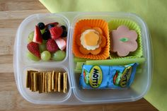 Spring Lunchbox: Simple deli box, filled with lunch meat, cheese, celery, Mott's Medley Fruit Snacks, crackers and a fruit salad. Simply cut out your deli meat and cheese with a small flower cookie cutter to create a fun, spring-has-sprung feel.