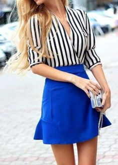 Chic blonde woman in royal blue skirt and striped shirt