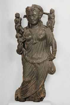 The goddess Hariti with three children Sikri, Khyber Pakhtunkhwa province 2nd–3rd century CE Schist H. 36 1/4 x W. 14 3/16 x D. 5 1/8 in. (92 x 36 x 13 cm) Lahore Museum, G-102.  [entry by LH on 30 March 2014].