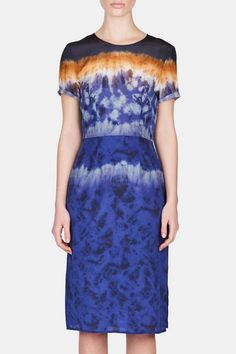 """Different from every angle, layered tie-dye keeps first impressions in flux. This silk crêpe de Chine dress evokes lacquered ceramics, an ode to the Basque handicrafts that inspired Joseph Altuzarra's spring 2016 collection. The designer acknowledges something """"really esoteric"""" about the print and its vivid waves of color (cobalt, navy, rust, white), but a soft, flattering shape and sumptuous, natural fabric ground the look. A side-slit hem adds an urban twist. """"It's always sexy,"""" says…"""