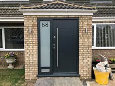 Modern front entrance security door in the well known Anthracite Grey. Porch Uk, House Front Porch, Porch Doors, Front Porch Design, Porch Designs, Modern Front Porches, Modern Front Door, Modern Entryway, Front Door Steps