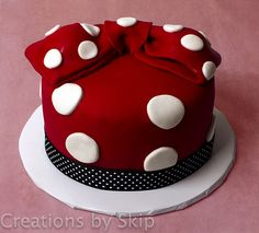 minnie mouse cake. It's perfect: red, polka-dots, and cake! What could be better?
