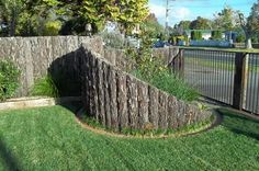 Dig a trench to sit the ponga in. They should be in the ground about 500- 600mm, depending on the overall height of the fence. A rule of thumb is 1/3 in the ground, 2/3 out of the ground, as deep as you can, so just the ground holds them, because there is no steel holding the curved fence.
