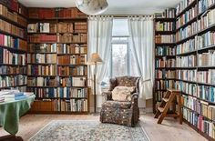 home library with built in book shelves