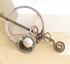 Handcrafted penannular shawl pin or scarf pin with spiral circle and white pearl on button and a pin stick
