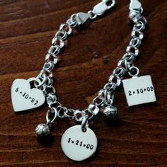 This sterling silver thick rolo bracelet is available in 7″, 8″ or 9″ andincludesthreethick namecharms: a heart, circle and square.