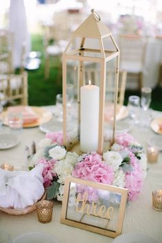 Elegant pink, white, and gold centerpieces   Dan Stewart Photography
