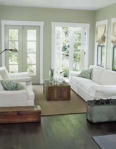 I love the soft green-blue wall color, and the simplicity of the room. The French doors complete it all.