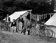 """Wabbit Season: 1910 Circa """"Rabbit-hunting party of six men, with bicycles, guns and dogs, including rabbits strung between two tents. Possibly Christchurch district."""" Now where'd we put that cookbook? Glass negative by Adam Maclay. Vintage Photographs, Vintage Photos, Bicycle Pictures, Shorpy Historical Photos, Rabbit Hunting, Nz History, Velo Vintage, Vintage Bicycles, Hunting Party"""
