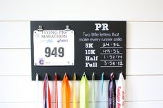 So cute!! Great place to keep bibs and medals. Love that you can write your PR's down - definitely would help with motivation to keep doing better!