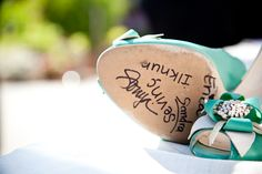 bridesmaids sign the bottom of the bride's shoes...great keepsake idea