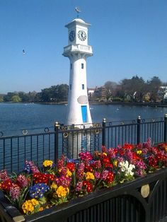 Roath Park, Cardiff, Wales. Scott Memorial F. C. Bowring 1915, Roath Park Lake. The clock tower commemorates Captain Scott's ill-fated expedition to the South Pole in 1910. A model of his ship, the Terra Nova can be seen at the top of the tower.