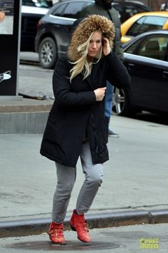 Sienna Miller wearing Chloe Flat Studded Boots and Woolrich Arctic Parka in Black.