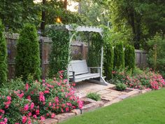 Double Pink Flower Carpet roses in front of 'Emerald Green' arborvitae. 'Fuji Masume' clematis on the fence behind. Arbor Swing, Garden Swing Seat, Garden Arbor, Garden Fencing, Garden Swings, Arborvitae Landscaping, Front Yard Landscaping, Landscaping Ideas, Flower Carpet