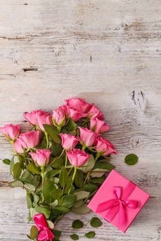 Buy Bouquet of pink roses by grafvision on PhotoDune. Bouquet of pink roses on wooden background, space for your text