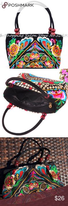 "Thai Embroidery Boho Wood Beads Zipper Purse NWT Lovely NWT handbag in vivid colors on sturdy black nylon canvas.  Front and back intricate floral embroidery designs in gold, silver, turquoise, pinks, purple, white, and green, possibly of Thailand, India, or Peru.  Full length top zipper opening. Brilliant, strong black nylon lining with 4"" inner pocket.  8 floating rich wooden beads on 16"" black handles.  Tote is 12"" long, 6"" tall, with a 5"" base.  We ship fast, offer bundle discounts, and…"