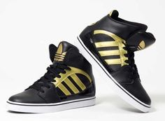 watch f21ee e07cd Gold and black Adidas high tops