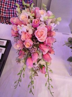 cascading bouquet of pink roses, white dendrobium orchids and pink waxflower - by bloom boxx