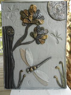 "Announcing the newest addition to my collections: Journal covers!  These mini murals are made entirely of polymer clay and will grace the front of your favorite spot to jot down thoughts and memories!  This one is called: ""Silver Night Hawk"" Comes with a journal. $45"