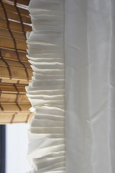 Elegant narrow French pleat drapery paired with fabulous woven wood shades. Drapery Panels, Curtains With Blinds, Window Curtains, Curtain Trim, Curtain Rods, Drapery Styles, Woven Wood Shades, Custom Window Treatments, Passementerie