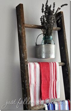{love the flowers hanging. So unexpected!} Vintage ladder with tin bucket and mason jar = so cute! ♥
