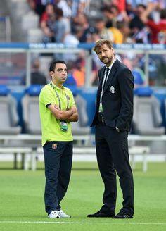 Xavi Hernandez of Barcelona talks to Fernando Llorente of Juventus prior to the UEFA Champions League Final between Juventus and FC Barcelona at Olympiastadion on June 6, 2015 in Berlin, Germany.