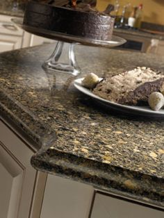 Silestone Black Canyon Quartz Kitchen Countertop With Brown Cabinets