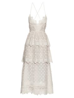 This white tiered cotton-blend voile dress is a perfect example of Self-Portrait's head-turning intricacy. Delicate lace trims the plunging neckline and ruffled skirt, while crisscrossing corsetry anchors the back. It's a flawless option for summer events – simply finish the look with all-white accessories.