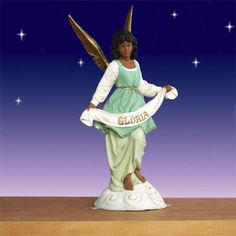 "African American Angel of Gloria 54"" scale Outdoor-Our African American Angel of Gloria stand upon the clouds.  Crafted from a patented eight step manufacturing process using the highest-grade fiberglass resin and innovative technology which makes this statue light weight and incredibly durable. Dimensions: L19"" W31"" H57"" $469.00 http://www.christmasnightinc.com/c39/c260/African-American-Angel-of-Gloria-54-scale-Outdoor-p1300.html#"