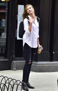 Karlie Kloss wearing Frame Denim Le Color Jeans in Film Noir, J.Crew Loungefly Star Wars Darth Vader 3-D Backpack and Rodarte Pointed Snake Embossed Booties