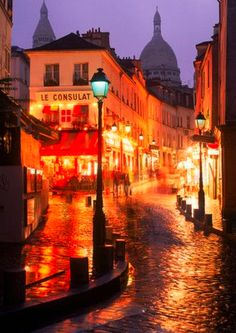 Paris in the rain... these streets are beautiful!