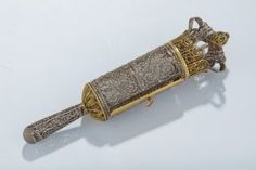 A FILIGREE MEGILLAH HOLDER WITH ORIGINAL MEGILLAH.