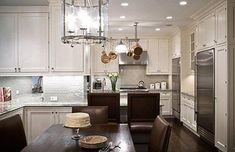 Small spaces need not be :: Jennifer Flanders Interior Design  ~gorgeous kitchen design with white kitchen cabinets, granite countertops, gray glass roman brick mosaic tiles backsplash, polished chrome lantern pendant, brown leather dining room chairs, stainless steel appliances, pot rack and rustic wood dining table. white ivory brown gray kitchen colors.