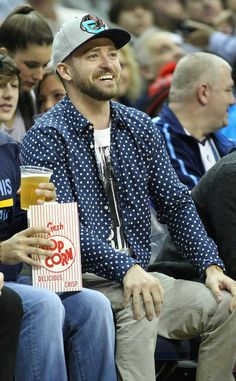 JT sits courtside during aMemphis Grizzlies game in Miami.